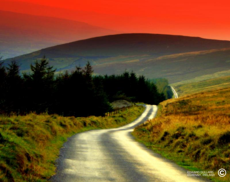 Winding road into sunset