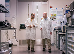 Neurosurgeon Steve Schiff and electrical engineer Srinivas Tadigadapa have joined forces to create a tiny magnetic device that can interact with brain cells without physically penetrating the brain. Image_ Patrick Mansell