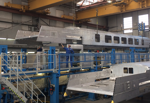 First electric train car_s upper and lower carbody being spliced together.