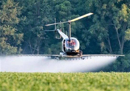 helicopter sprayer_ theheliteam.com