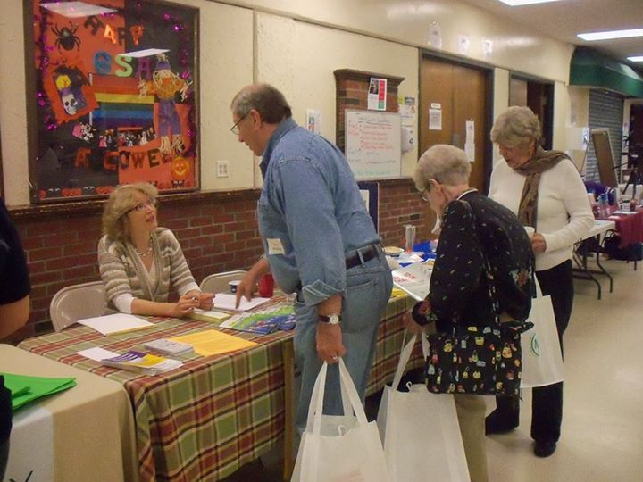 Attendees at the 2014 Senior Health & Wellness Fair speak with a local health provider.
