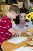Kindergarten teacher working with student