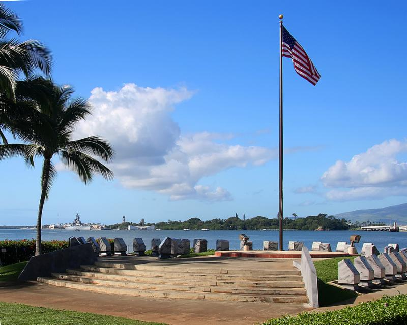 The America flag flying at Pearl Harbor.