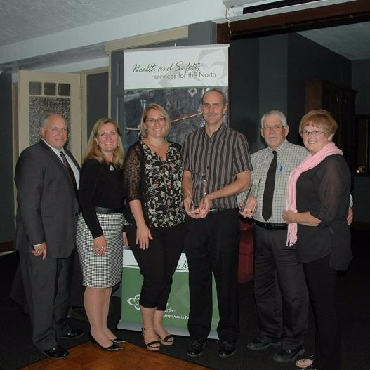 Fleming's accepts safety award from WSN