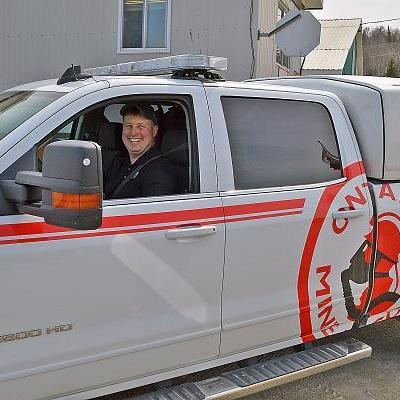 worker driving emergency vehicle