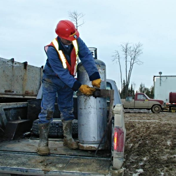 worker with propane cylinder