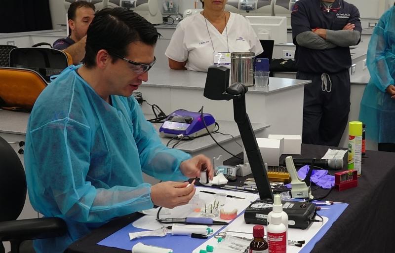 Dr. Marco Brindis demonstrating hybrid denturesfabrication techniques