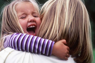 hugging-child-laughing.jpg