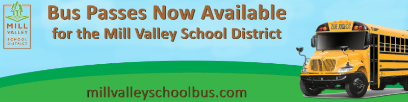 A school bus with grass and a blue sky that says Bus Passes Available now for the Mill Valley School District millvalleyschoolbus.com