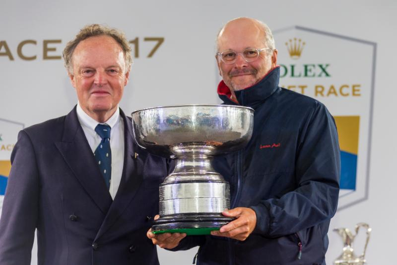 Proudly holding the Fastnet Challenge Cup_ winner of the 2017 Rolex Fastnet Race_ Didier Gaudoux with RORC Commodore_ Michael Boyd _ Rolex_Carlo Borlenghi