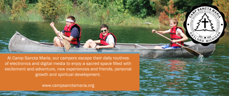 Boys in Canoe with logo and mission statement