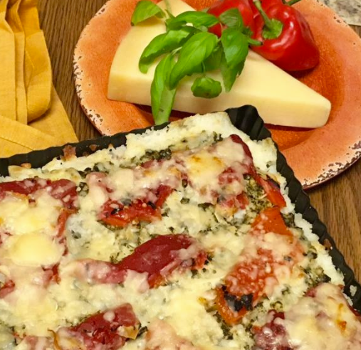 rice pizza and a wedge of Parmesan cheese