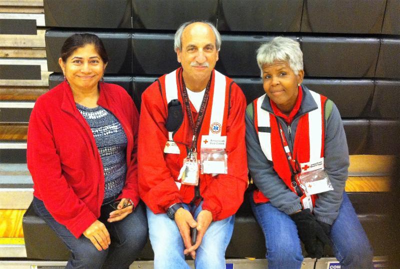 GOPIO's Rini Johar with Red Cross volunteers Ken Burns and Janice Kent
