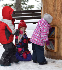 kids at the book tree in winter
