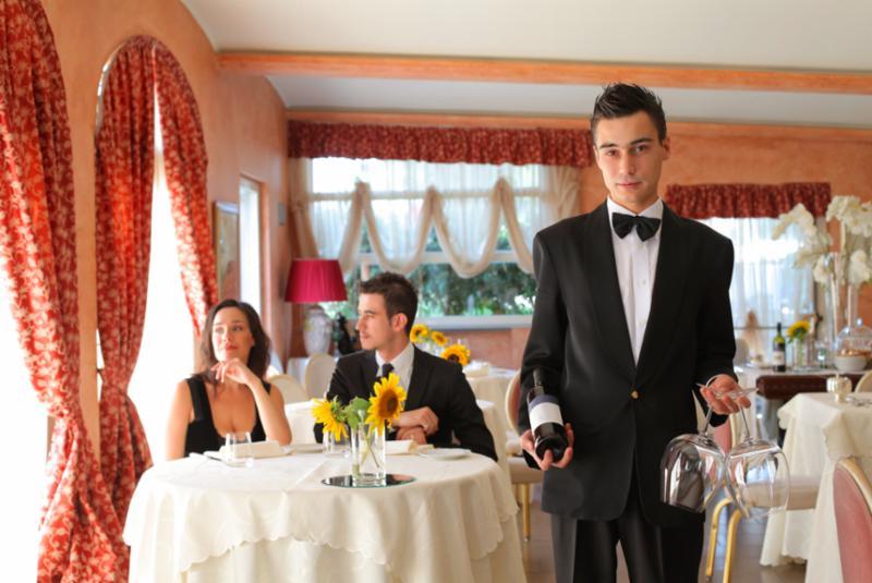 couple_waiter_wine.jpg