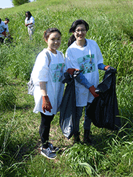 Trash Bash girls picking up trash
