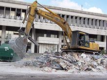Heavy construction equipment moving debris