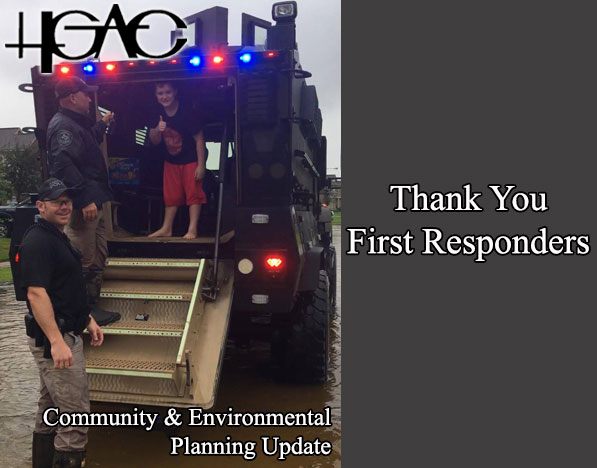First Responders let a young community member see inside of a rescue truck.