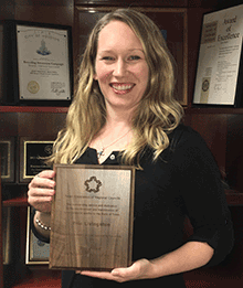 Erin Livingston with Solid Waste Planner of the Year plaque