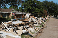 pile of debris in front of a home following a flood event