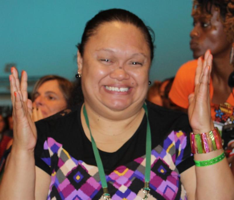 Leona Tamainai applauding in Sign Language