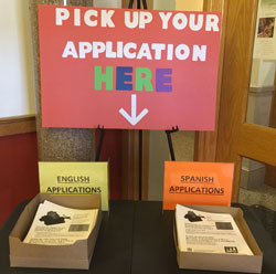 Signage that says _Pick up your application here_