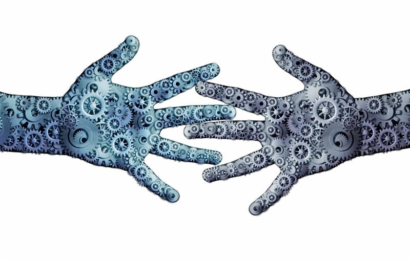 Working business teamwork concept as a group og mechanical gears and cog wheels shaped as two human open hands as a symbol for cooperation technology partnership or robotic artificial intelligence icon.