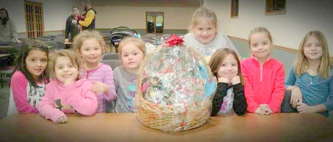Muscatine Troop 2551.  They created a Christmas basket for a senior citizen. Because of their awesome generosity_ these girls in grades K-1 earned the Friendly _ Helpful petal.