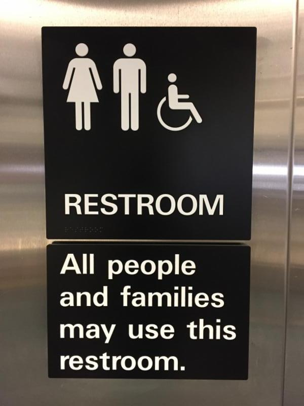 gender-neutral bathroom sign that reads _restroom_ all people and families may use this restroom._
