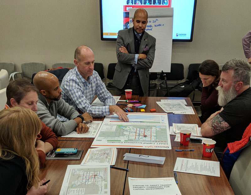 task force members gather around maps at meeting