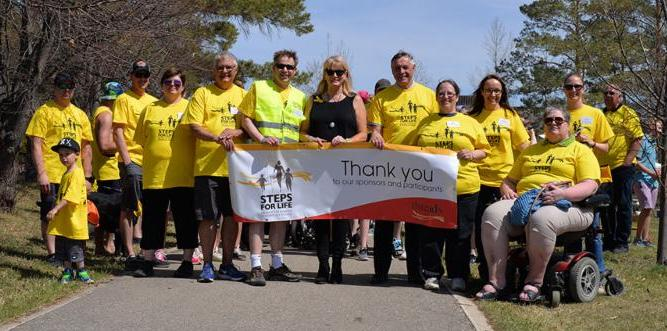 Saskatoon walkers with a Steps for Life thank you sign.
