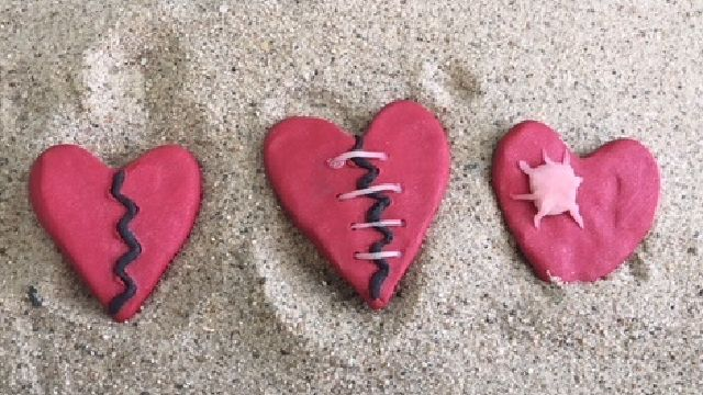 three hearts in sand