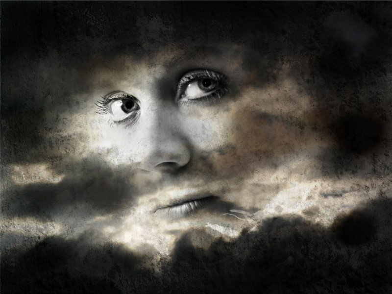 face in clouds