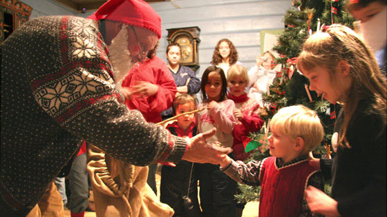 A julenisse _Christmas elf_ hands out gifts at Vesterheim_s annual Norwegian Christmas event.