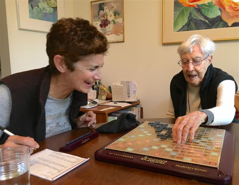two women playing scrable