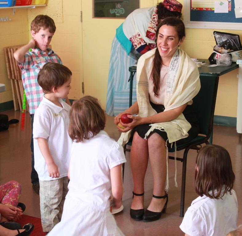 Our chazzan, Daniela Gesundehit, teaching a song to children in the kids' program at Rosh Hashanah