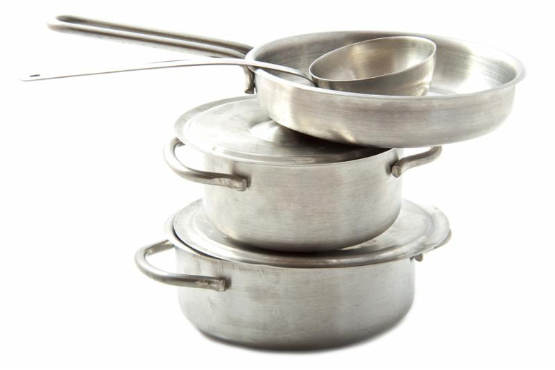 Stainless pots and pans on a pile