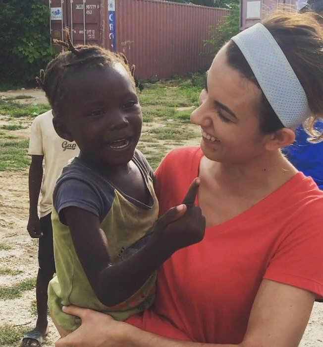 LPN Eve Varghese with Haitian child