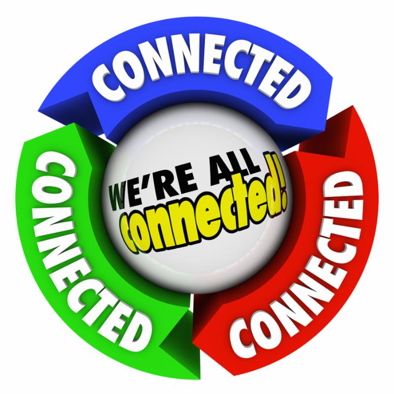 The word Connected on arrows around a spehere with the saying We re All Connected to illustrate humanity and people together in a community or society on the same team