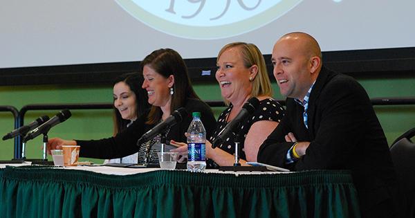 A photo of four panelists