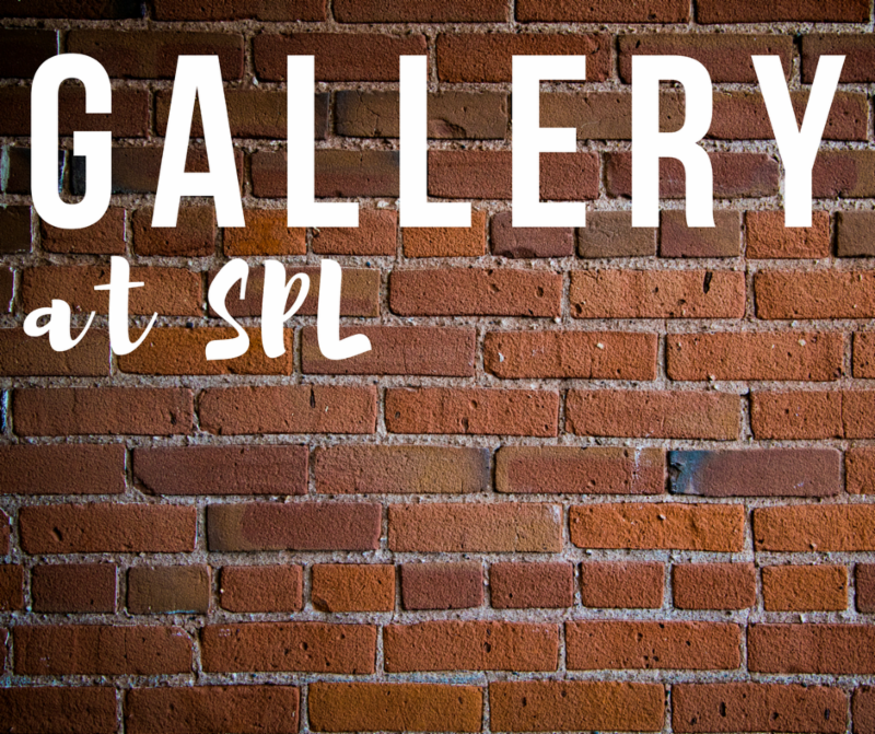 Gallery at SPL on brick wall