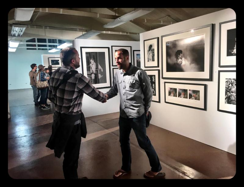 Jack Johnson (r) greeting fan at the Morrison Hotel Gallery PopUp Gallery at Monterey 50th