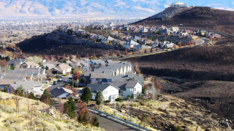Aerial view of houses and burnt landscaping after the 2011 Caughlin Fire.