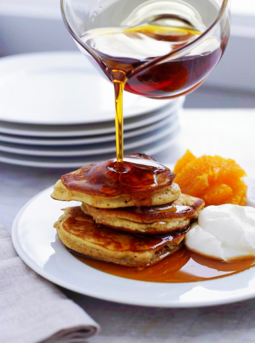 pancakes syrup oranges cream pour white breakfast brunch plates