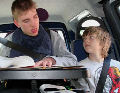 Two children in adapted car