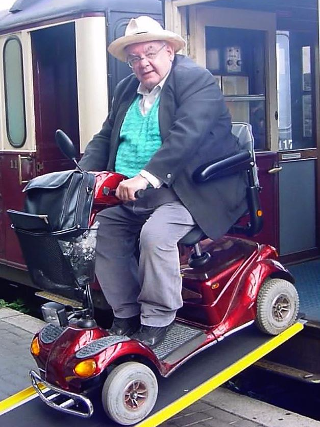 David Roberts on mobility scooter leaving train