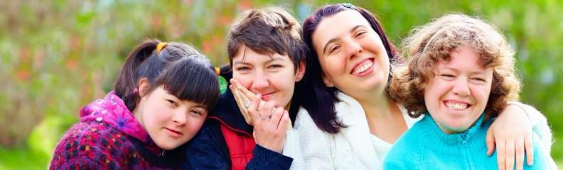 4 young women smiling from an adults' social friends group