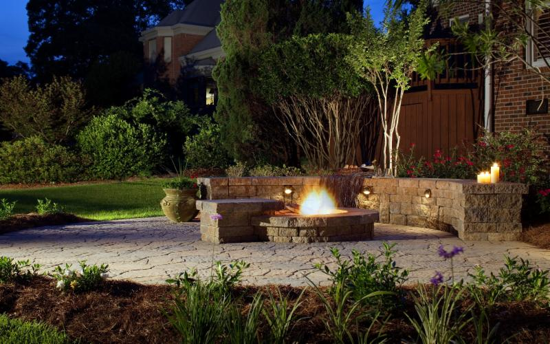 Picture of a backyard landscape with a patio fire pit and more with Belgard stone - available from Hillermann Nursery and Florist