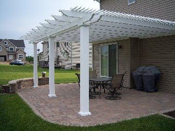 Landscape patio with a pergola
