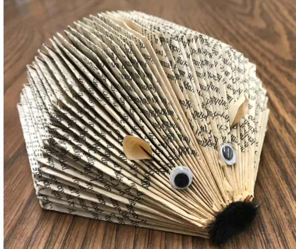 Paper hedgehog made  by folding book pages.
